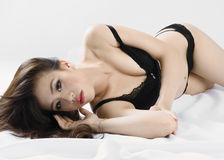 Sexy Chinese woman laying on her side. Stock Images