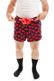 Christmas Gift - Guy in Boxers. Humorous photo of a guy in boxer shorts with a bow, offering his crotch as a Christmas gift. Isolated on white stock photos