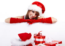 Sexy christmas girl. Smiles and holding a gift in  packing Stock Image
