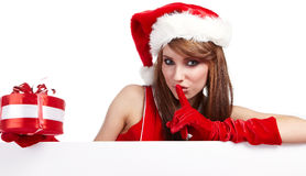 Sexy christmas girl. Smiles and holding a gift in  packing Stock Photo