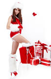 Sexy christmas girl. Smiles and holding a gift in  packing Royalty Free Stock Images