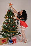 Sexy Christmas girl decorating the tree Stock Photos
