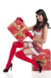 Sexy christmas girl holding a big gift box Royalty Free Stock Photos