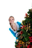 Sexy christmas girl look from fir tree Stock Image