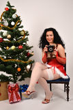 Sexy Christmas girl with photo camera Royalty Free Stock Photos