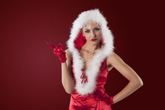 Sexy christmas girl in red. Beautiful and sexy girl posing in a red and very short christmas outfit with white feathers Stock Photo