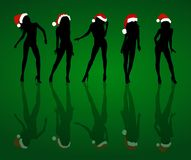 Sexy Christmas Girls. An illustrated background of the silhouette of five sexy girls wearing Santa hats Stock Photography