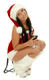 Christmas party girl. A christmas party girl with glass of red wine royalty free stock photo