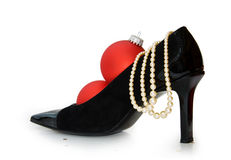 Sexy Christmas stilettos isolated - clipping path. Sexy black stilettos with red christmas baubles isolated on white with clipping path included for easy removal Stock Photo