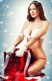 Sexy christmas woman with big red xmas gift Royalty Free Stock Photo