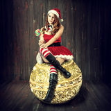 Sexy christmas woman in santa claus clothes Royalty Free Stock Image