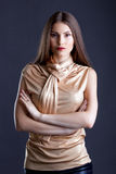 confident model posing in beige blouse Royalty Free Stock Photos