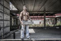 Sexy construction worker shirtless with muscular Royalty Free Stock Image