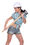Sexy construction worker. With a sledgehammer Stock Photography