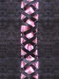 Corset Closeup. A black lace and pink corset closeup stock photo