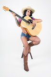 Sexy Country Girl with Guitar Royalty Free Stock Photography