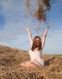 Sexy country girl  play with hay Royalty Free Stock Photos