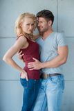 Sexy Couple with Arms Around Each Other Royalty Free Stock Photography