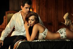 Sexy couple in bedroom Royalty Free Stock Image
