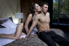 Sexy couple in bedroom Stock Photography