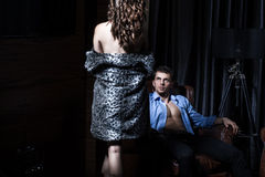 Sexy couple in bedroom, dark room Royalty Free Stock Photography