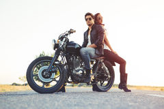 Sexy couple of bikers on the vintage custom motorcycle Royalty Free Stock Images