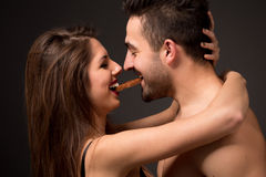 Sexy couple with chocolate in studio Stock Image