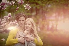 Couple. couple in love. happy couple in love in spring magnolia. Flowers, smiling men and girl in garden with blossom tree outdoor on natural background royalty free stock images