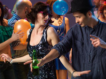couple dancing, flirting in night club Stock Photos