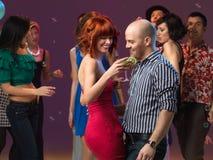 Sexy couple dancing, flirting in night club Stock Image