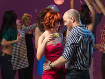 Sexy couple dancing, flirting in night club Royalty Free Stock Image