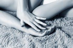 Couple doing erotic massage in bedroom. Couple doing erotic massage in bedroom on green blanket. Close-up shot in hands stock image