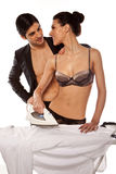 Sexy Couple Doing Ironing Royalty Free Stock Photography