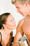 Sexy couple with dumbbells in gym Stock Images