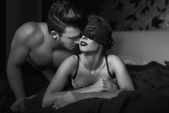 Sexy couple foreplay in bed black and white Royalty Free Stock Image
