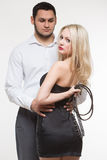 couple. girl holding a leash. dog collar Royalty Free Stock Image