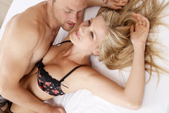 Sexy couple having fun in bed. Royalty Free Stock Photo