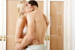 Sexy couple hugging in Bedroom. Stock Photo