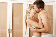 Sexy couple hugging in Bedroom. Royalty Free Stock Images