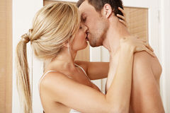 Sexy couple hugging in Bedroom. Stock Images