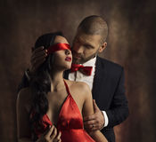 Sexy Couple Love Kiss, Man Kissing Sensual Woman in Blindfold. Sexy Couple Love Kiss, Man in Suit Kissing Sensual Woman, Red Fashion Blindfold on Girl Eyes Stock Images