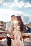 Sexy Couple in love kissing and hugging on the backdrop of fabul Royalty Free Stock Photography