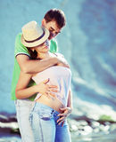 couple loving on the rocky coast Royalty Free Stock Photos