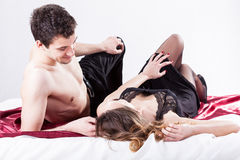 Sexy couple lying in bed Royalty Free Stock Photography
