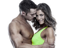 Sexy couple, muscular man holding a beautiful woman isolated on Stock Photo