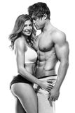 Sexy couple, muscular man holding a beautiful woman Stock Images