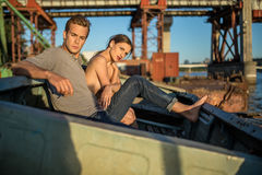 Sexy couple in old boat Royalty Free Stock Photography