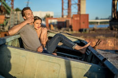 Sexy couple in old boat Royalty Free Stock Images