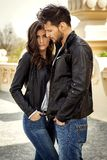 Couple in leather jacket. Couple outdoor wear leather jacket and hugging each other stock photo