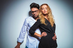 Sexy couple pose in studio background while looking down Royalty Free Stock Image